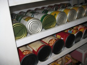 Rotation method: Use slanted shelves for your cans.